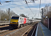 Class 91 No.91125 has charge of 1D15 the 13.00 service from Kings Cross to  Leeds as it sweeps north through Welham Green.<br /> <br /> 10 March 2015