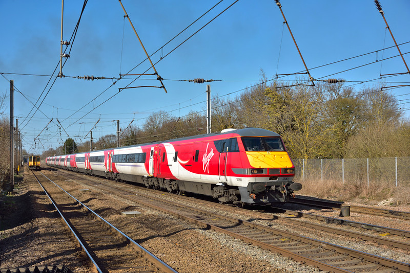 Sporting a brand new Virgin livery, DVT 82200 leads 1A28  the11.45 Leeds to  Kings Cross south past Welham Green.<br /> Propelling at the rear is Clas 91 No. 91105<br /> <br /> 10 March 2015