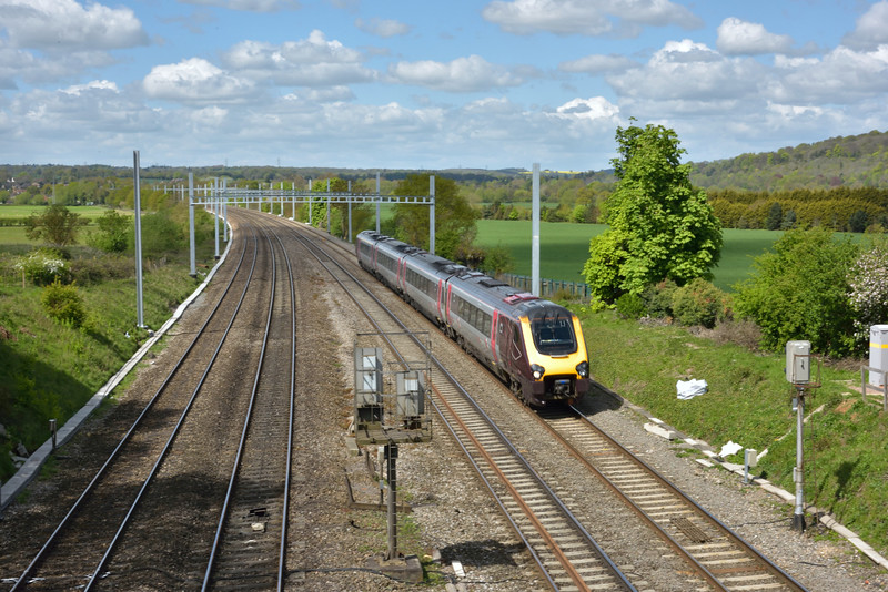 1O84 the 07.25 Newcastle to Southampton Central service formed with an XC Voyager set clears the overhead masts as it passes Purley in the Thames Valley on its journey south.<br /> <br /> 28 April 2015