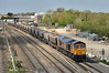 GBRf 66765  makes a slow progress away from West Drayton leading 6B11  empty hoppers from Colnbrook Lafarge  to Pengam Reception Sidings<br /> <br /> 22 April 2015