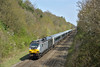 Speeding past Beaconsfield is Chiltern 68010 propelling 1H53 12.55 service from  Birmingham Moor Street to London Marylebone<br /> <br /> 20 April 2015