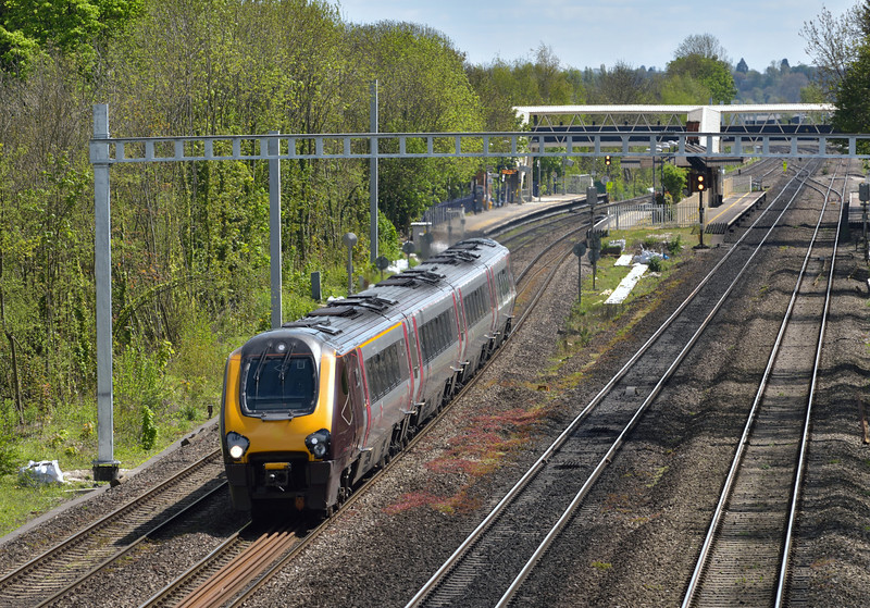 An unidentifiable XC Voyager  forming 1E44 11.46 from Southampton Central to Newcastle powers through Tilehurst beneath the rapidly encroaching masts.<br /> <br /> 28 April 2015