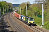 Running about 30 minutes late due to disruption between Didcot and Oxford, 'Ugly' 70009 nears Tilehurst at the head of 4O70  Wentloog  to Southampton Maritime freightliner.<br /> <br /> 28 April 2015