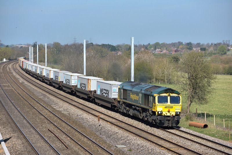 66594 is working hard as it passes Lower Basildon with 4L30  Bristol  to Felixstowe North Freightliner<br /> <br /> 14 April 2015