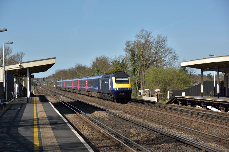 The diverted  07.53 Exeter St Davids to London Waterloo (1O36) speeds through Hersham formed with with power car 43175 leading 43098<br /> <br /> 12 April 2015