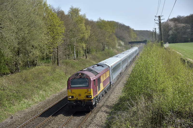 EWS liveried 67008 raises the dust and it races through Seer Green at the head of 1R37 13.15 service from London Marylebone to Birmingham Moor Street<br /> <br /> 20 April 2015