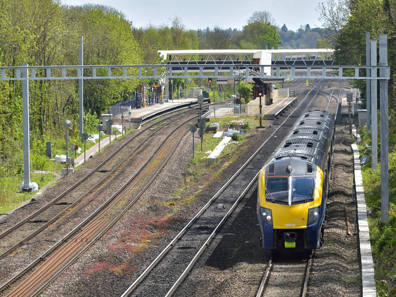 Adelante 180108 races through Tilehurst with 1W32 12.21 London Paddington to Great Malvern service.<br /> <br /> 28 April 2015