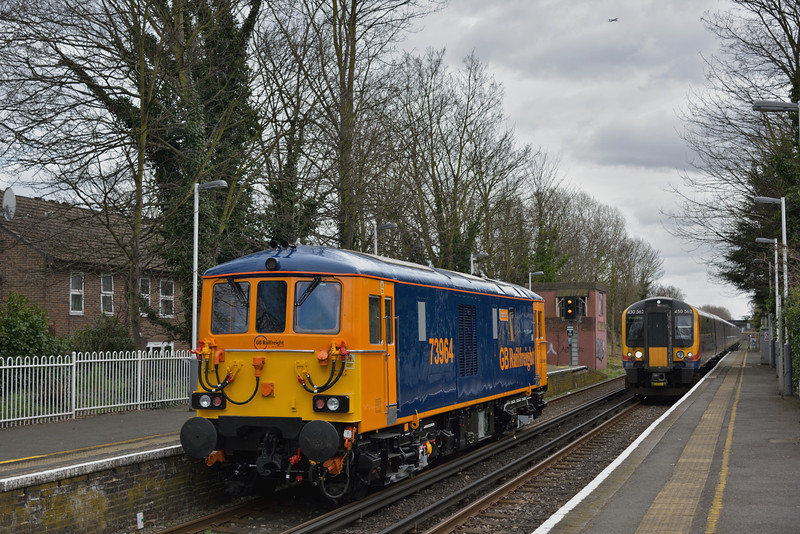 Rebuilt ED No.73964 passes Chiswick on its delivery run from Loughborough Brush to Tonbridge West Yard and is nearly bowled by 450562 approaching with 2S33 from Waterloo to Weybridge<br /> <br /> 1 April 2015
