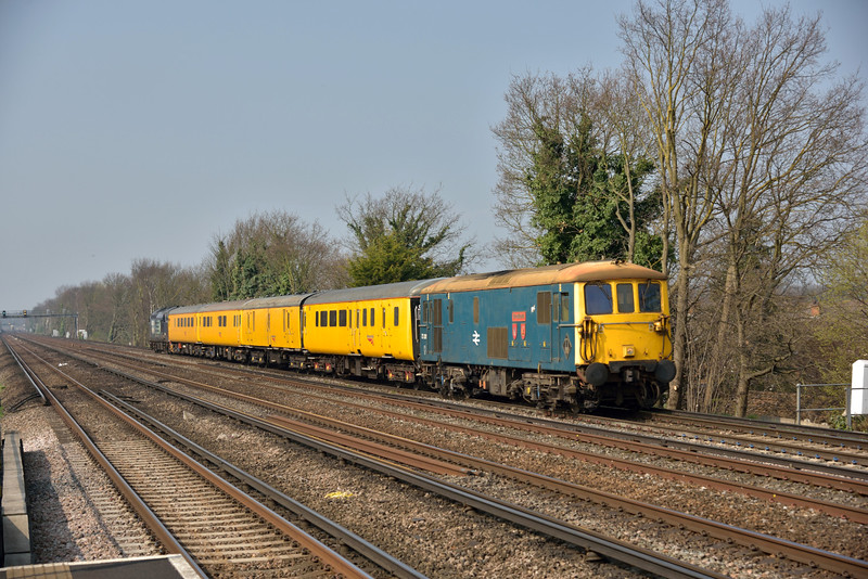 73201 displays  a remarkable turn of speed as it passes Hersham with test train 1Q82 working from Woking to Hither Green via Waterloo.<br /> <br /> 8 April 2015