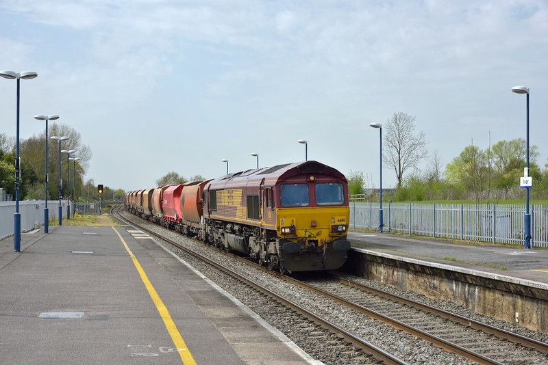 EWS 66110  trundles through Iver wiith loaded hoppers forming 6M20  from Whatley Quarry to Churchyard Sidings <br /> <br /> 16 April 2015