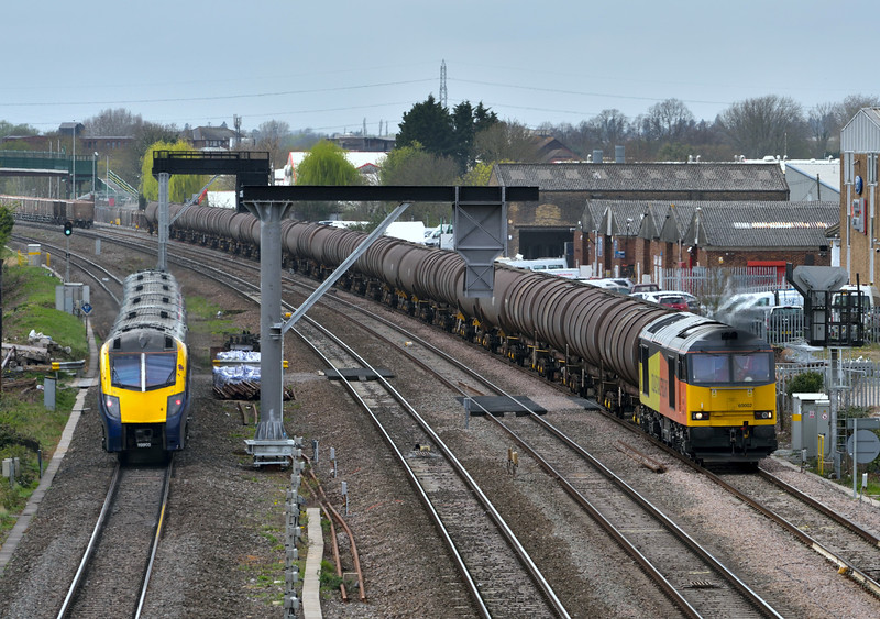 Colas 60002  passes Stockley Park  with 6E38 tanks from Colnbrook  to Lindsey Oil Refinery as Adelante 180103 heads west with the 14.21 from  Paddington to Worcester Foregate Street  (1W41)<br /> <br /> 13 April 2015