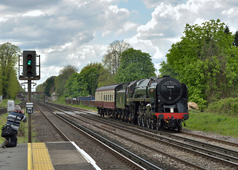 BR Pacific No.70000 ' Britannia' passes West Byfleet with its support coach as it returns from Swanage as 5Z70 to Stewarts Lane.<br /> <br /> 27 April 2015