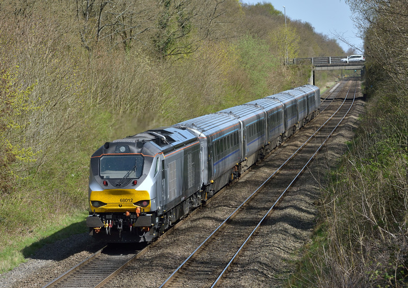Chiltern Class 68 No.68012 roars through Beaconsfield propelling 1H53 the 12.55 service from  Birmingham Moor Street to  Marylebone<br /> <br /> 15 April 2015