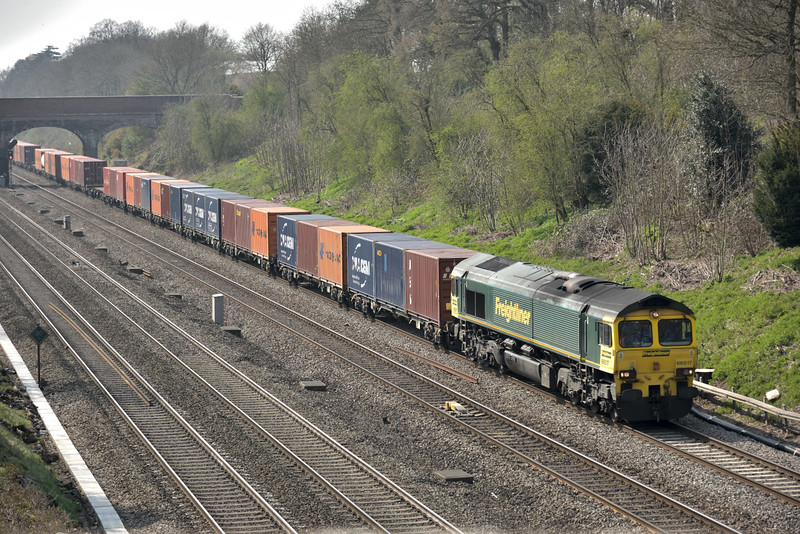 66517 has sole charge of  4L31 liner  from Bristol  to Tilbury<br /> Seen passing Southbury Lane, Twyford<br /> <br /> 9 April 2015