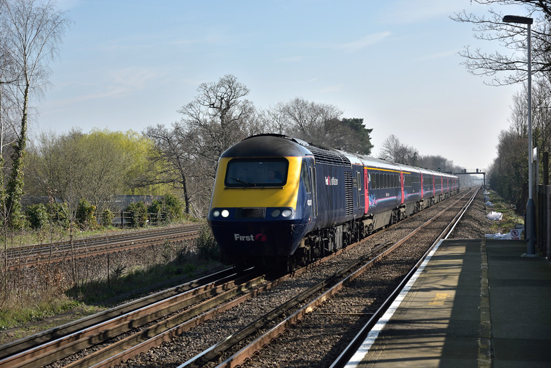 Power car 43147 speeds through Walton on Thames at the head of diverted 1V36 10.07 service from London Waterloo to Plymouth<br /> <br /> 6 April 2015
