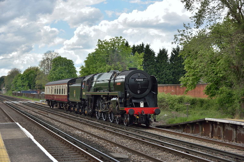 Running almost 20 minutes earlier than expected BR Pacific No.70000 ' Britannia' passes West Byfleet with its support coach as it returns from Swanage as 5Z70 to Stewarts Lane.<br /> <br /> 27 April 2015