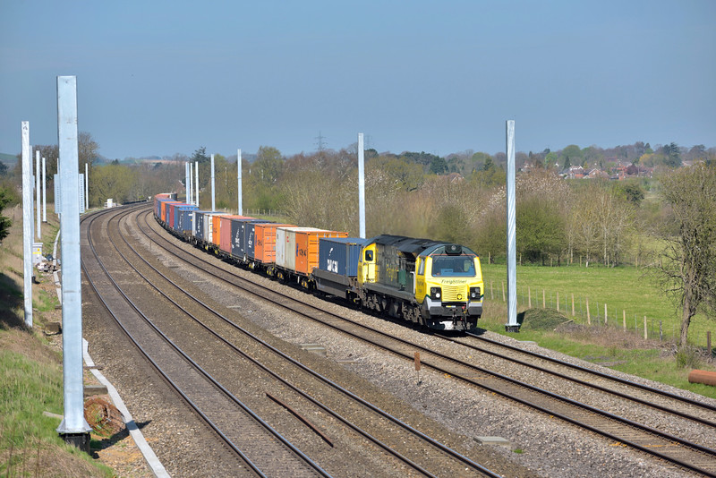 70008 passing Lower Basildon at the head of 4O54 Leeds  to Southampton Maritime frightliner<br /> It is becoming apparent how the scene will soon change forever as the masts take over.<br /> <br /> 14 April 2015