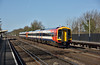 A bright morning at Hersham sees Class 159s 159108 / 159002 pass through with  1L28 the 08.54  from Gillingham (Dorset) to Waterloo<br /> <br /> 12 April 2015