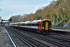 159102 wearing the amended SWT chevron livery speeds through Weybridge at the head of  1L28 the 09.21 service from  Salisbury to Waterloo <br /> <br /> 28 December 2015