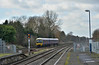 Seen passing Iver non-stop, I think this was the 11.39 from Bedwyn to Paddington 1K53  formed with Turbo165108<br /> In the distance some of the first OHLE masts are just visible.<br /> <br /> 4 February 2015
