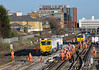 A pair of Balfour Beatty track machines get ready to do their stuff during engineering work at Wimbledon West<br /> <br /> 10 January 2015