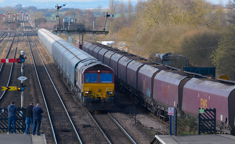 The photographers are out at Barnetby as 66063 thunders through with  Biomass hoppers working from Drax Power Station to Immingham.<br /> <br /> 24 March 2015