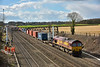 66170 passes Milley Bridge with diverted 4E69 Southampton W Docks  to Wakefield Europort freightliner<br /> The first OHLE structure is now taking place and the cutting is lined with foundation pilings for the masts.<br /> <br /> 3 March 2015