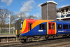 "450114 ""Fairbridge"" halts at West Byfleet with 1A38 the 12.28 service from Farnham to London Waterloo<br /> <br /> The Fairbridge project is one of SWT community  sponsorships supporting young people.<br /> <br /> 2 March 2015"