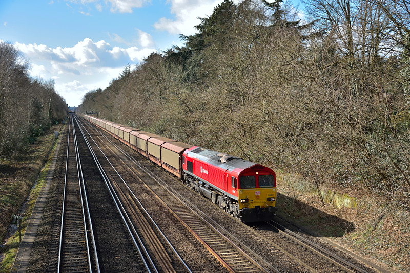Gleaming in the spring sunshine DBS class leader 66001 rolls through Sheerwater with 6M48 car carriers from Southampton Eastern Docks to (Jaguar Cars) Halewood  <br /> <br /> 2 March 2015