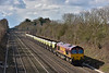 EWS liveried 66008 finds a spot of sun on a bitterly cold day as it passes Shottesbrooke at the head of  6M31  Banbury Reservoir  to Mountsorrel Sidings hoppers.<br /> <br /> 3 March 2015