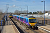 A mixture of old and new at Hatfield as First TP 185102 pauses with 1B68 the 07.53 from Manchester Airport to Cleethorpes as Pacer 142089  continues on to Lincoln.<br /> <br /> 27 March 2015