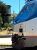 Profile of the Surfliner's P42 power, backed by a water tower that remains from the days of steam locomotives.