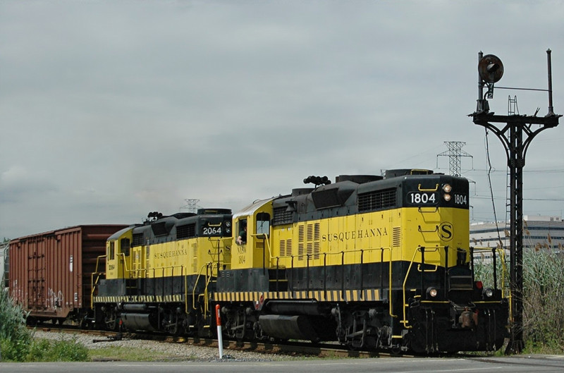 NYS&W  EMD GP18  1804 leads GP20  2064  across 69th St. in North Bergen, N.J.