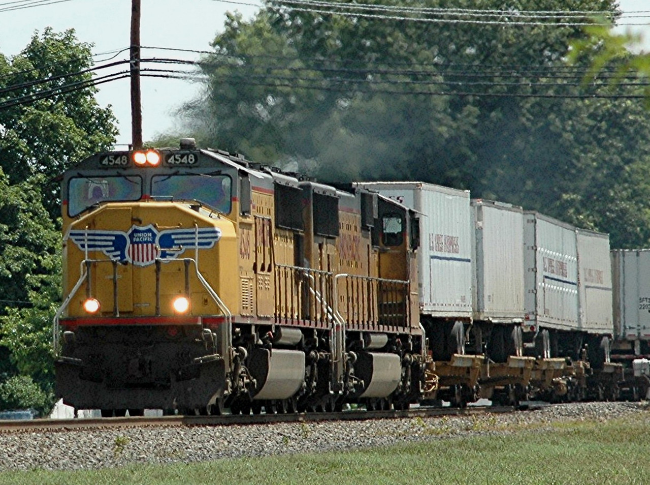 Union Pacific  SD70-M  4548 pushes west from Oak Island yard in Newark N.J. on thr Lehigh Line  Photo taken at 16th St. crossing  at Manville , N,J.