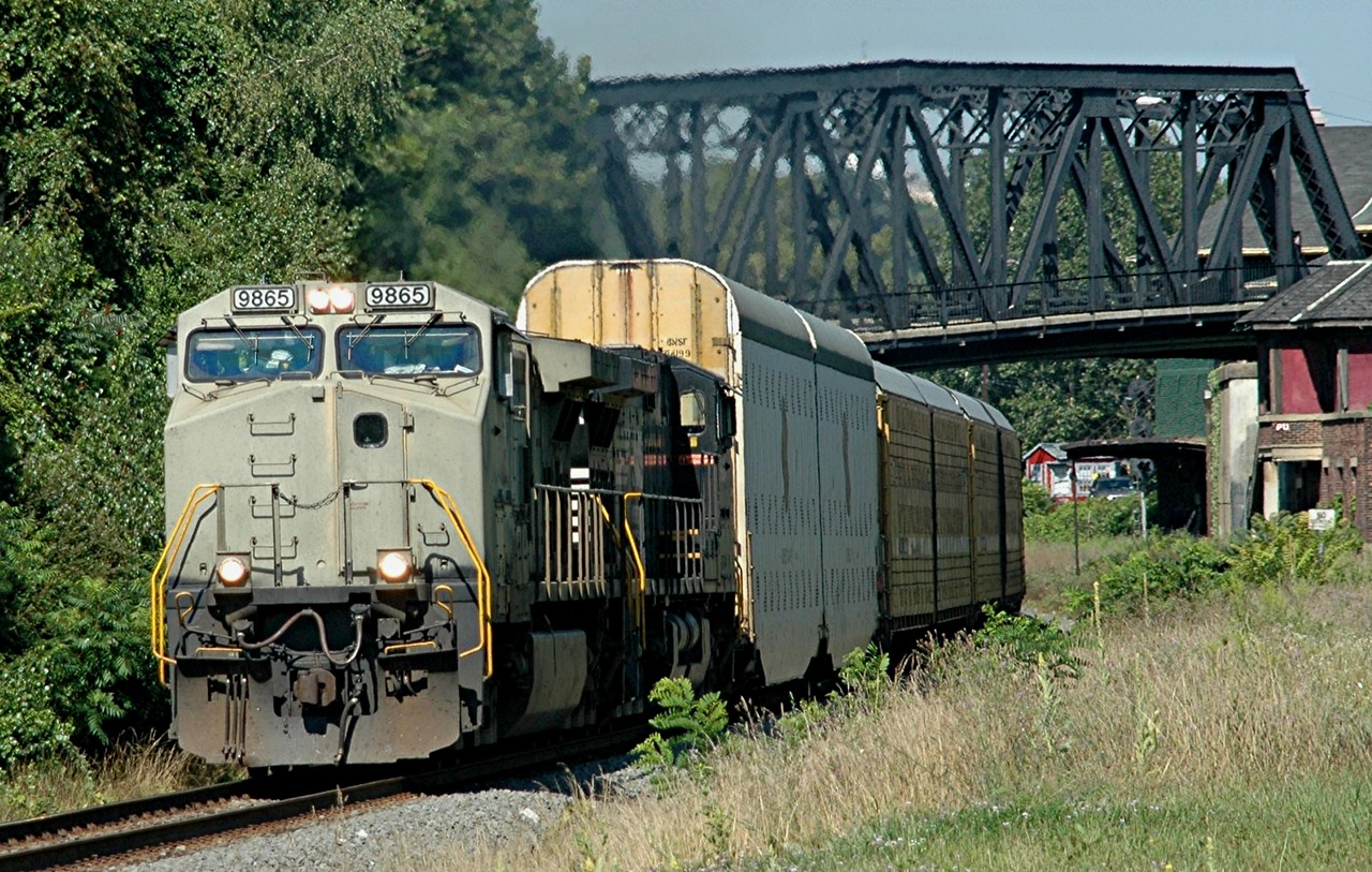 Norfolk Southern C40-9W  9865  This unit was delived in Primer , leads this Auto Rack east bound  through Phillipsburg, N.J.