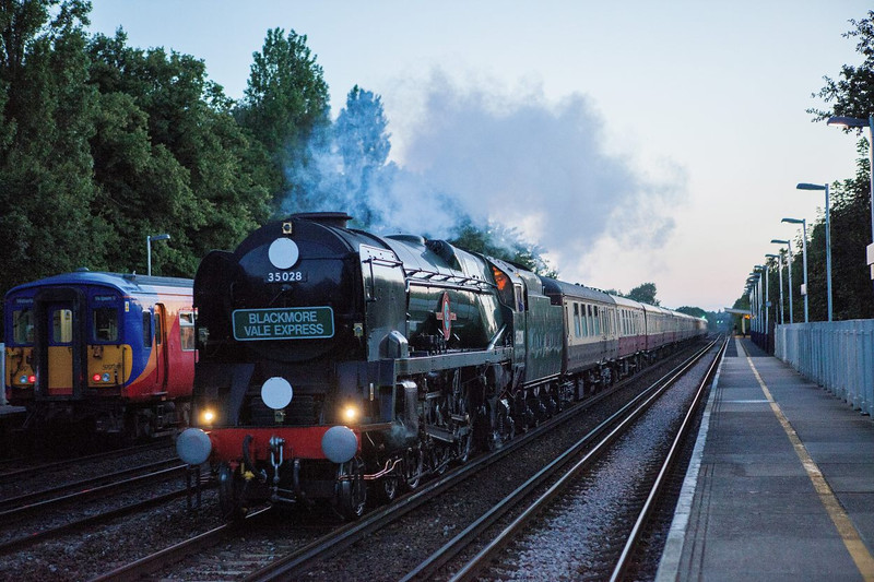 BR Merchant Navy No 35028 Clan Line roars through Hersham at sunset with the returning Blackmore Vale Express to Waterloo<br />       <br />  16 July 2011
