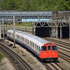 LUL underground Bakerloo line unit No.3253 heads south to Elephant and Castle through Kenton<br /> <br /> 5 August 2011