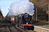 BR Britannia Class 7MT 4-6-2 no 70000 Britannia races through Addlestone with 'The Cathedrals Express' from Southend - Winchester<br /> <br /> 10 December 2011
