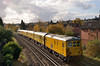 73138 leads, 73201 Broadlands on 1Q85 through Egham. <br /> 73138 is running 'wrong way around' with cameras etc at rear of loco.<br /> <br /> 1 November 2011