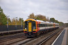 159020 races through Hersham with the 11.20 Waterloo - Exeter service<br /> <br /> 2  November 2011