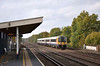 Desiro 444013 blows the leaves around as it passes a deserted Hersham station with an up service to Waterloo.<br /> <br /> 2  November 2011