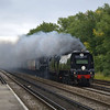 Originating at Waterloo,SR Light Pacific Class 4-6-2 No 34067 Tangmere and   BR Class 7MT 4-6-2 No 70000 Britannia<br /> doublehead 'The Atlantic Coast Express' through Hersham on an unbelievably dismal Sunday morning. <br /> Pity about the trailing smoke though!<br /> <br /> 4 September 2011