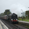 BR Britannia Class 4-6-2 no 70013 Oliver Cromwell at the head of 1Z94 'The Dorset Coast Express' passing a very wet Addlestone<br /> <br /> 6 September 2011