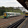 A crossing of EMU stock at South Kenton<br /> 377215 on a Southern service to Milton Keynes passes 378225 on a Watford bound train<br /> <br /> 15 September 2011
