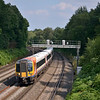 444011 catches a patch of light between clouds as it passes Pirbright with the 14.35 Waterloo - Brockenhurst<br /> <br /> 10 August 2012