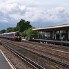 450040 races through Hersham with the 14.43 Basingstoke - Waterloo service<br /> <br /> 7 August 2012