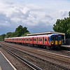 455910 halts at Hersham with the 15.19 stopping service to Waterloo<br /> <br /> 7 August 2012