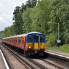 455904 rolls into Effingham Junction with the 12.54 to Waterloo via Surbiton<br /> <br /> 8 August 2012