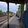 450092 rattles the platform at Hersham as it races past with the 15.15 semi fast service from Waterloo - Guildford<br /> <br /> 7 August 2012