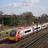 Alstom branded Pendolino roars north past Kenton<br /> <br /> 8 March 2012